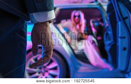 Fashionable couple in a car, at the evening