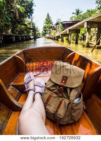 Woman Sitting On Canal Boat In Floating Market