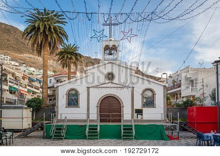 Small church and New Year decorations at Los Gigantes. Tenerife island, Spain.