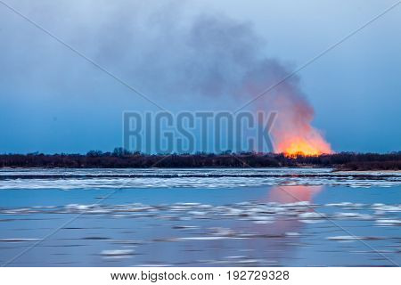 Forest fire in the spring during ice drift