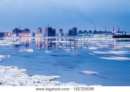 Ice drift in Khabarovsk in spring evening