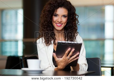 Woman using her tablet in a cafe