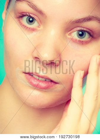 Close Up Woman In Facial Peel Off Mask.