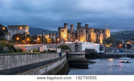 Conwy Wales United Kingdom - September 16 2016: World heritage Conway castle in Wales in evening. It was built between 1283 and 1289 and considered as one of the finest examples of late 13th century and early 14th century military architecture in Europe.
