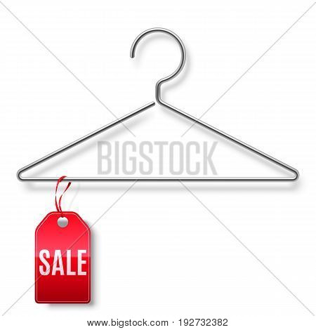 Clothes hanger with red sale tag isolated on white background
