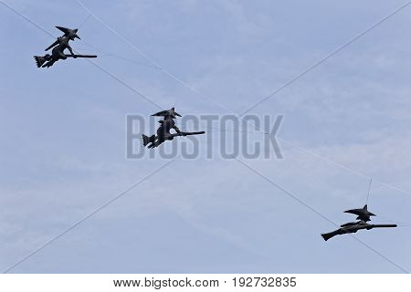 flying kites three black witches on broomstick