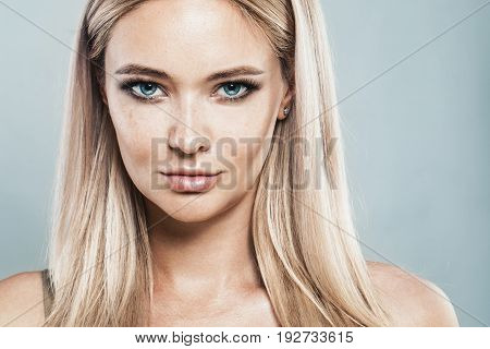 Beautiful Blonde Woman with Natural Makeup Blonde Hair and Freckles. Natural Beauty