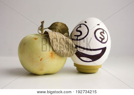 Business Concept. An Egg With Eyes Dollars