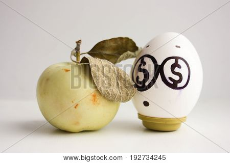 Business Concept. An Egg With Dollar Eyes