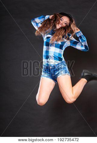 Happy And Joyful Woman Girl Jumping And Having Fun