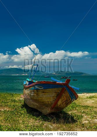 Looking out over the south china sea in Nha Trang bay on a beautiful sunny day with a vietnamese fishing boat in the foreground.