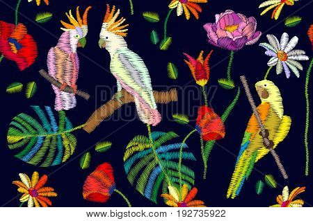 Seamless vector pattern with parrot, cockatoos flowers and palm leaves on black background. Stylized embroidered texture. Vintage motifs.