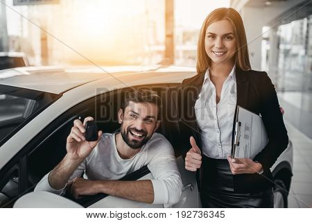 Salesperson With Customer In Car Dealership