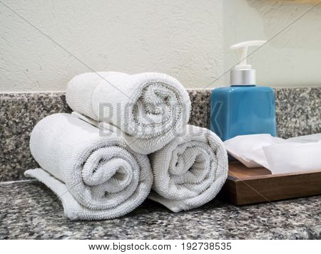 White towels on the wash basin in bathroom