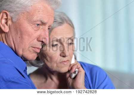 Portrait of sad senior couple, woman holding hand on cheek with toothache