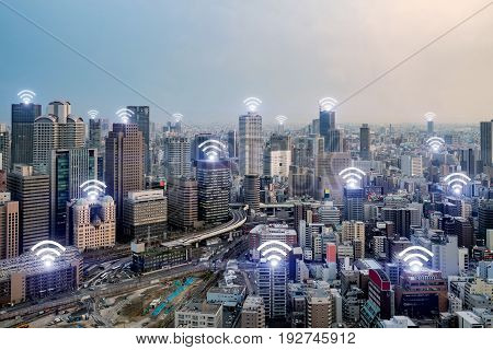 Wifi icon and Osaka city with wireless network connection. Osaka smart city and wireless communication network abstract image visual internet of things.