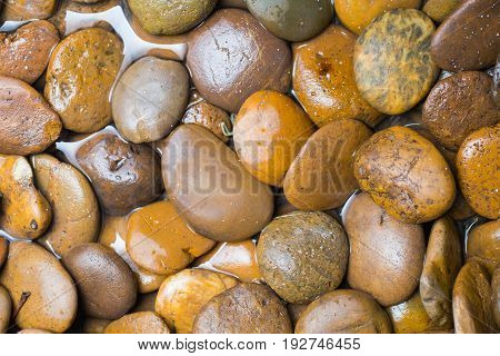 River Stone, Curve Stone Or Round Stone In Waterfall.