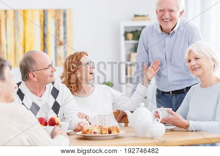 Happy senior people spending afternoon together at home