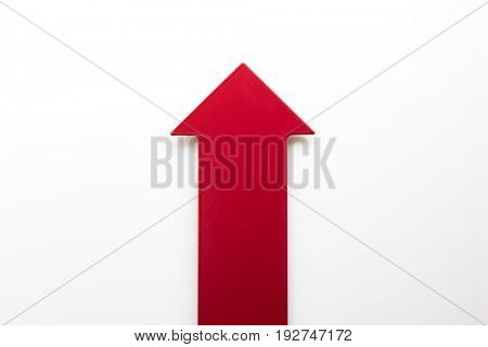 Big real red arrow for presentation or slide show. pointing up for growth or increase or boost. Natural white background.