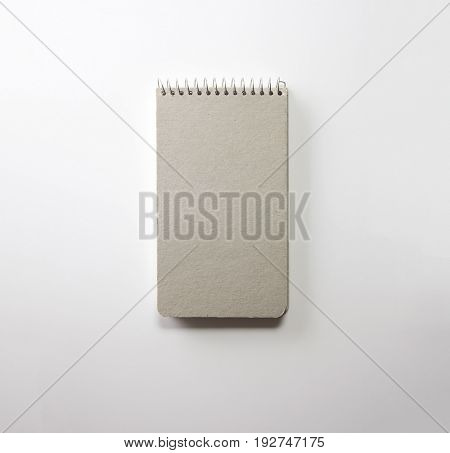 Memo pad or note pad with nice grey cover, isolated on natural white background.
