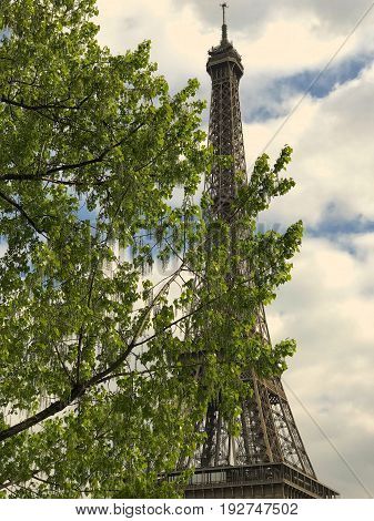 Majestic and imposing tower eifel under the clouds of a warm spring