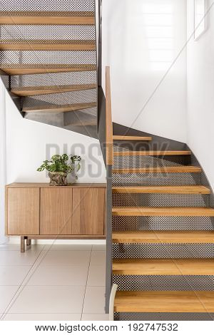 Industrial metal and wooden half-landing stairs in simple family home