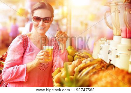Yougn woman with glass of fresh fruit juice