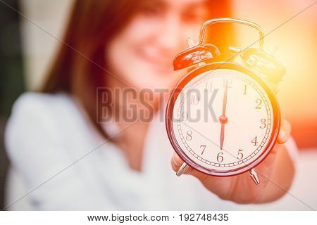 Time Remind Concept, Women Hand Up Show Clock Timed At 6 O'clock.