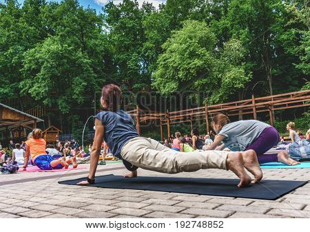 VORONEZH, RUSSIA - JUNE 18, 2017: A lot of people are engaged in yoga in the Dynamo park on the International Yoga Day in Voronezh, Russia