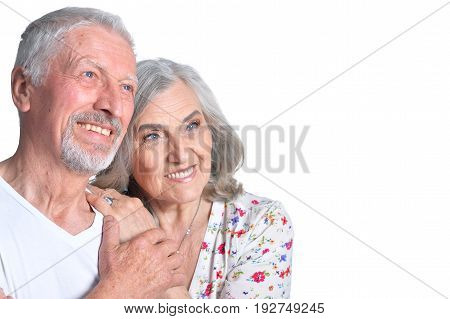 Studio portrait of happy senior couple isolated on white background