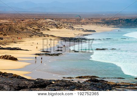 El Cotillo, Fuerteventura, Spain, April 03, 2017: Unknown People On A Beach In El Cotillo Village In