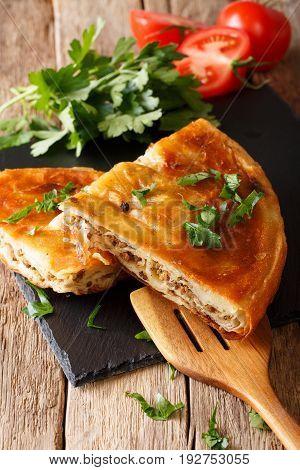 Homemade Sliced Burek Stuffed With Meat Close-up. Vertical