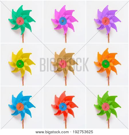 Collage of colorful pinwheels on white paper background