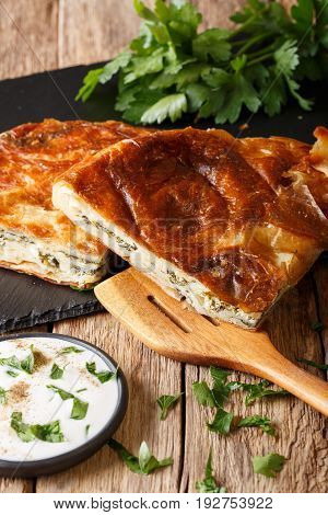 Burek Stuffed With Spinach And Cheese And With Sour Cream Sauce Close-up. Vertical