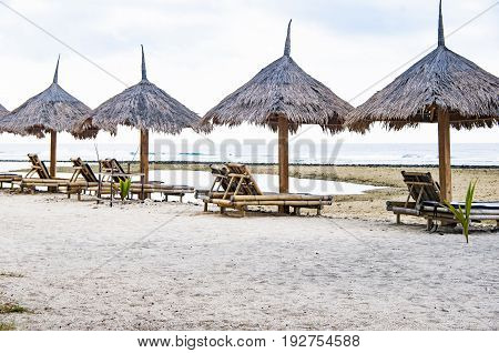 Bali long chairs on the beach in summer