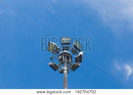 Spot-light tower over a blue sky background.