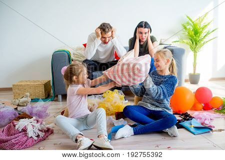 Kids romping at home creating a mess