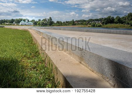 Pskov, a summer promenade on the background of the river and the Mirozhsky monastery