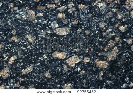 Stone Background Of Mottled Granite Igneous Rock Used For Kitchen Worktops Etc.