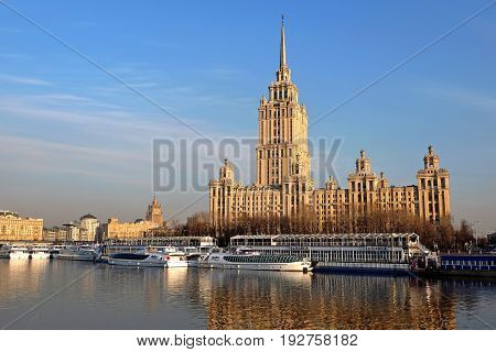 Moscow, Russia - August, 2016: Moscow river with cruise boat in front of Stalin Skyscraper - Hotel Ukraina of Radisson Hotel. Moscow Russia.