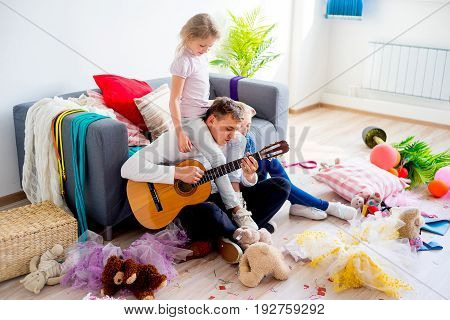 Girls playing and romping with their father