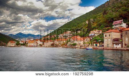 Old fishing village with traditional mediterranean stone houses in the Kotor Bay(Boka Kotorska), Montenegro.