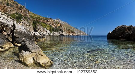 A small pebbles beach Lo Zingaro Nature Reserve in Sicily Italy