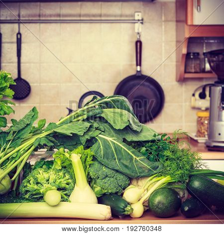 Healthy diet and meal ingredients concept. Many green vegetables on kitchen table