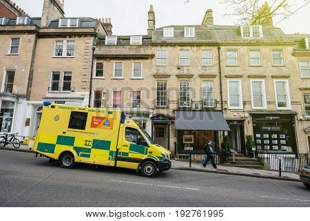 BATH, UNITED KINGDOM - MAR 7, 2017: Yellow British UK ambulance nhs ambulance, south western ambulance service fast motion in Bath, United kingdom