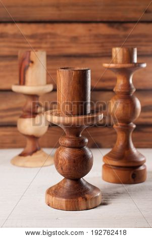 Wooden Candle Holders On Wooden Background Rural Style