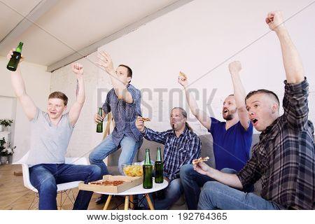 Friends Watching Winning Football Match