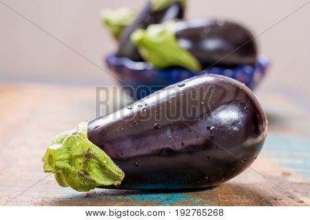 Ripe Raw Purple Eggplants On A Wooden Background
