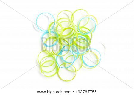 pile of part of plastic bottle cap rings isolated on white background