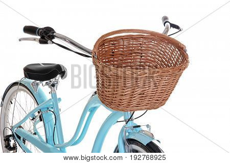 Modern bicycle with basket on white background, closeup